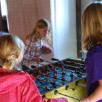 Kids playing fooseball in the apple barn