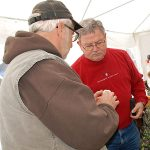 Les discusses garlic with visitor to the Big Stone harvest fest booth